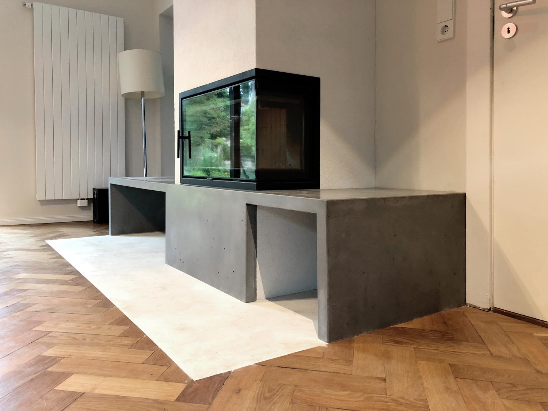 Beton-Design als Betonsitzbank mit Kaminumrandung